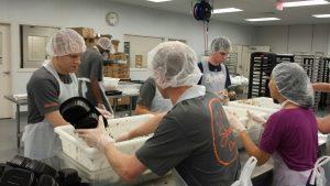 Volunteers prepare meals at Open Hand.