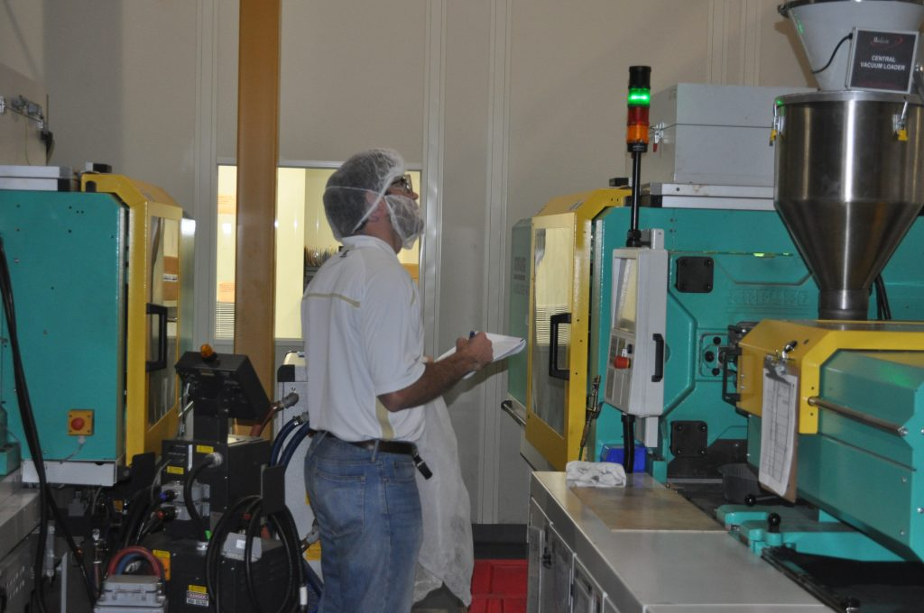 Georgia Tech student inspects equipment during an Industrial Assessment Center audit.