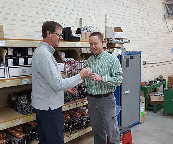 Derrick Gordy, Founder and Co-CEO of FizzDOG, discusses a component of their product with David Apple, GaMEP Project Manager.
